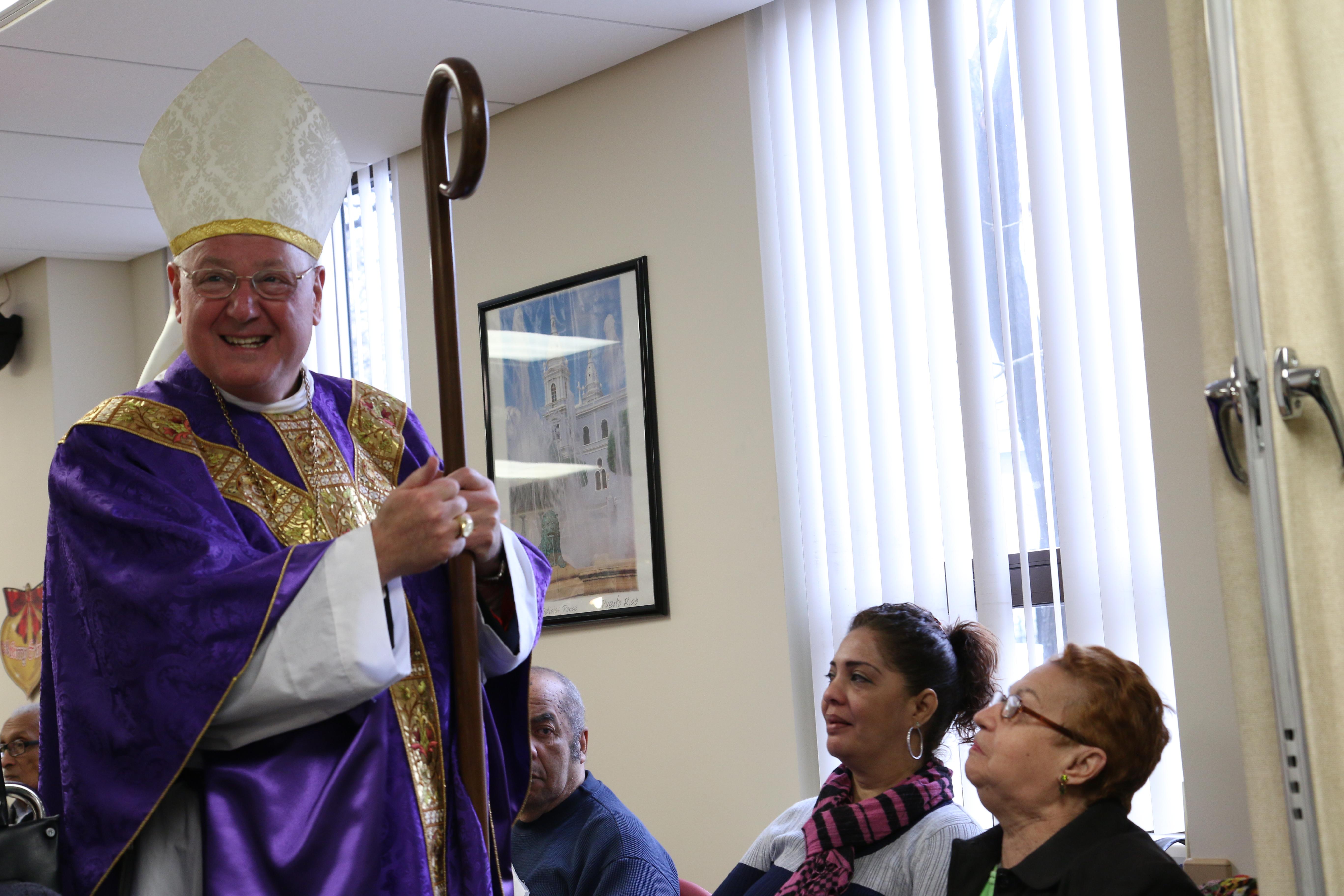 Cardinal visits Sandy survivors in Longwood