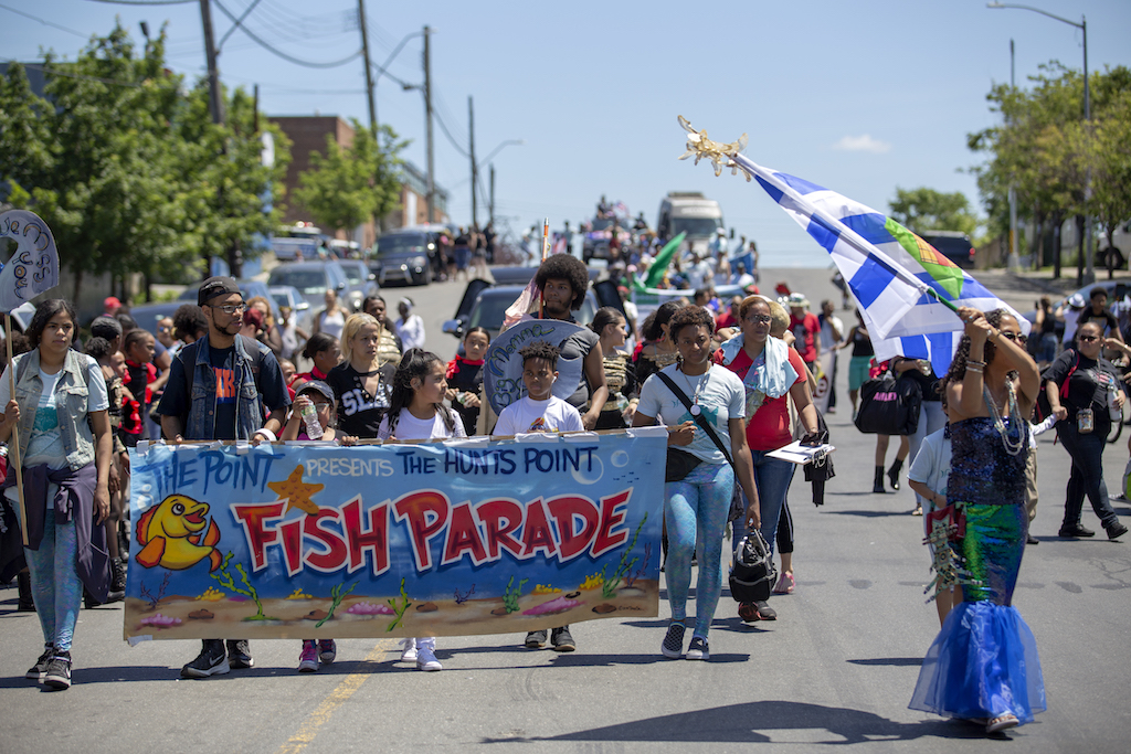 Fish Parade marchers salute Puerto Rico storm survivors